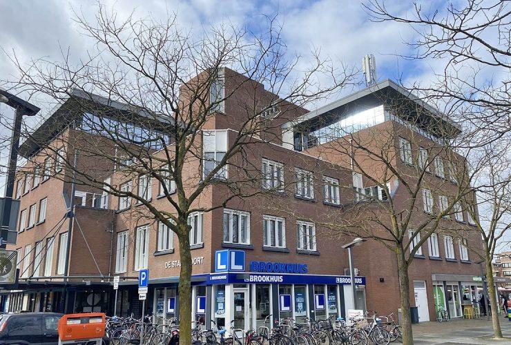 Voormalig kantoorpand de Stadspoort in Enschede met winkelruimte en appartementen verkocht